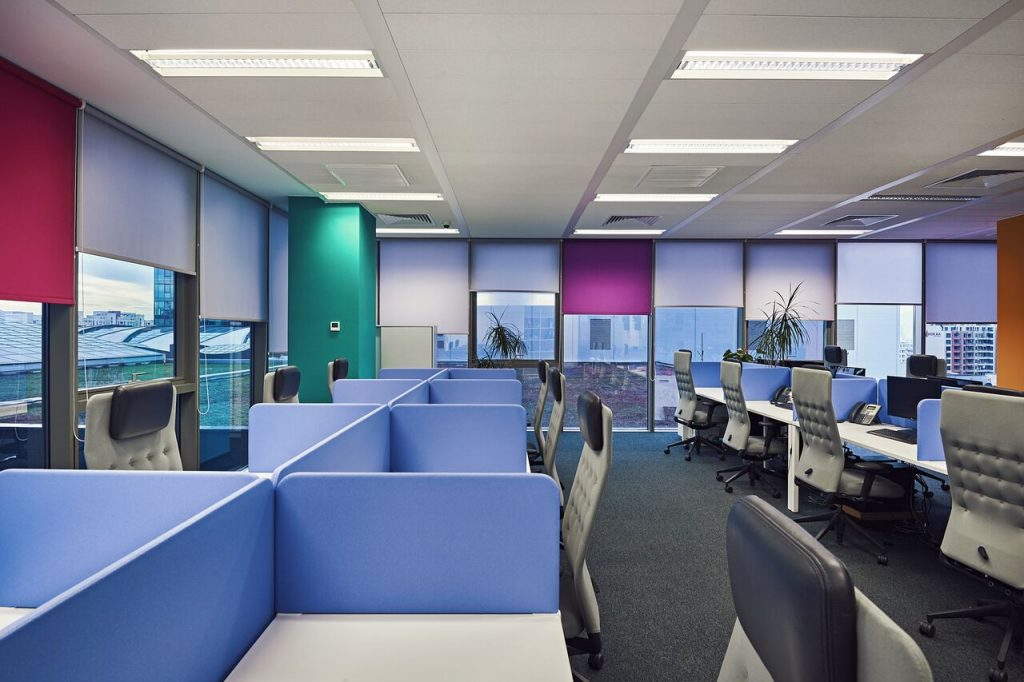 interior design of the modern office with desks and colorful accents